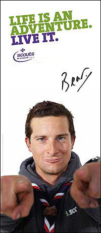 Picture of Bear Grylls, hands outstretched, both fingers pointing at you!